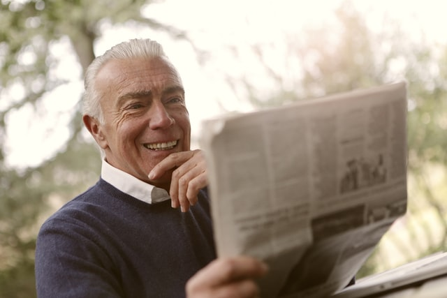 Elderly Man Reading Newspaper Retirement